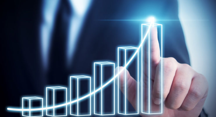 Businessman pointing arrow graph