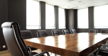 Modern meeting room with solid wood table