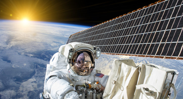 American astronaut on solar cells of the international space station - Elements of this image furnished by NASA