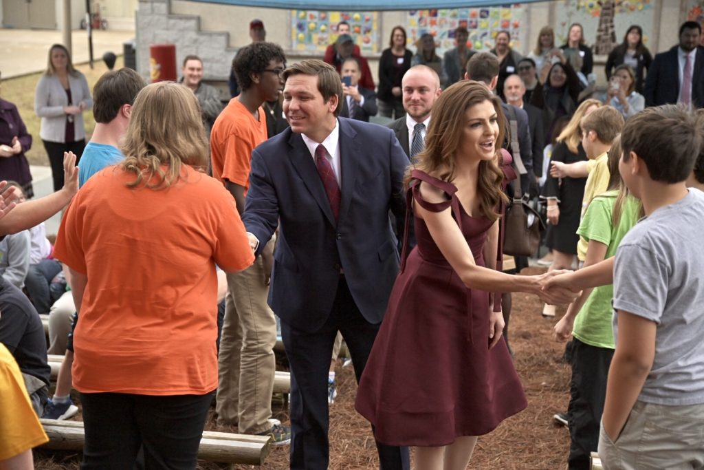 Gov. Ron DeSantis and First Lady Casey DeSantis shake hands with parents and students at North Florida School of Special Education in Jacksonville