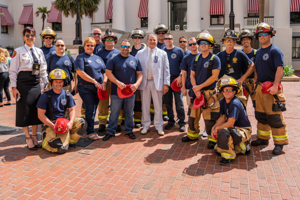 CFO and State Fire Marshal Jimmy Patronis poses with firefighters from across Florida in front of Florida's historic old capitol building.