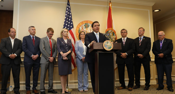 Governor Ron DeSantis pictured making announced that the Florida Department of State (DOS) and Florida's 67 County Supervisors of Elections will engage in a cooperative cybersecurity initiative ahead of the 2020 election.