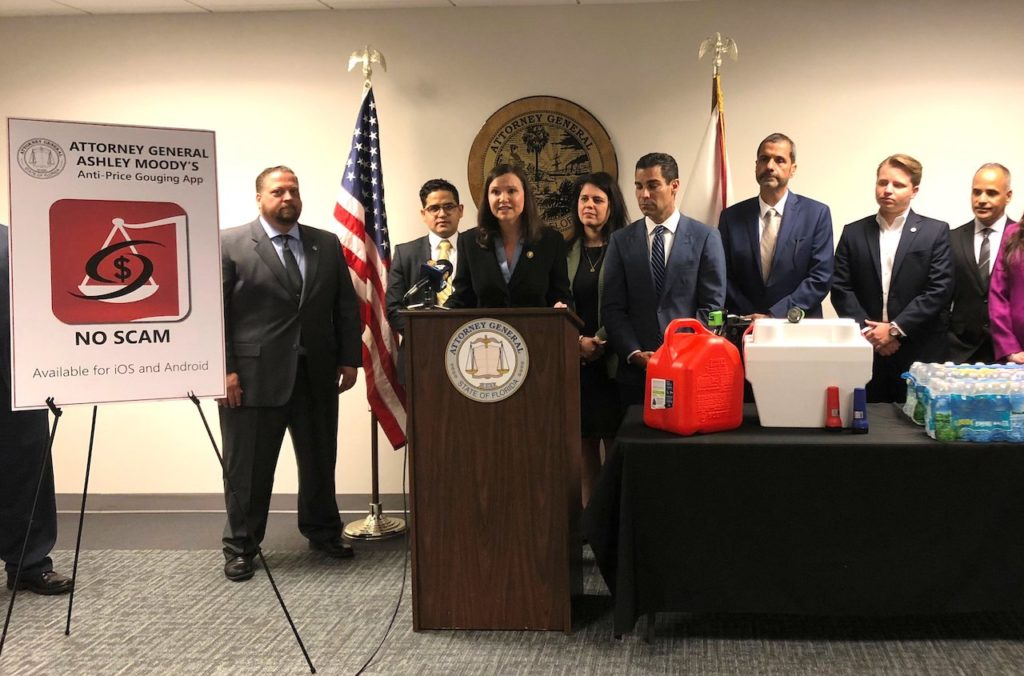 Attorney General Ashley Moody, pictured today at a press conference in Miami, urged Floridians to download the new price gouging app NO SCAM.