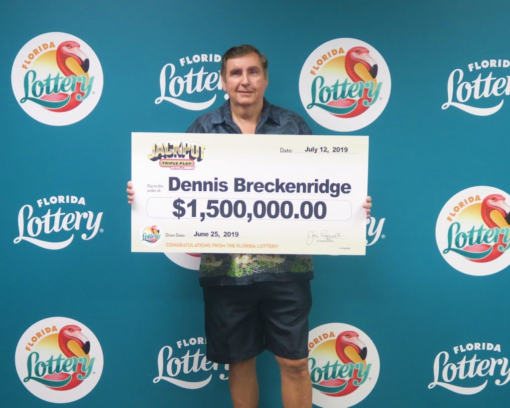 Dennis Breckenridge poses with his oversized check after claiming the $1.5 million JACKPOT TRIPLE PLAY jackpot from the June 25, 2019 drawing at Florida Lottery Headquarters.
