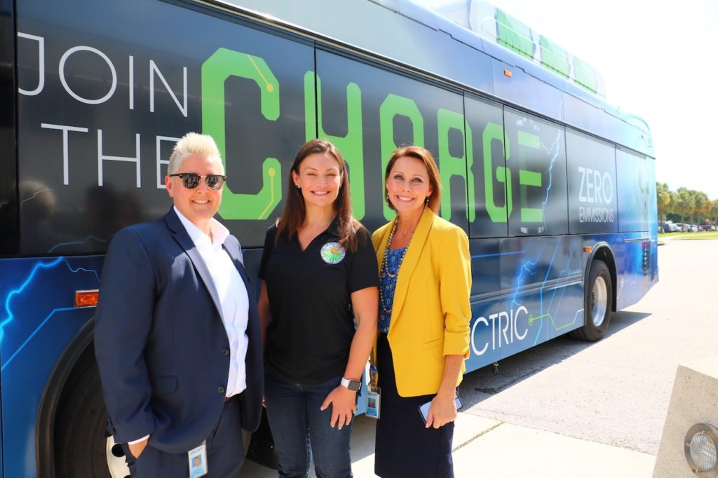 Commissioner Nikki Fried poses in front of one of PSTA's newest all-electric buses.