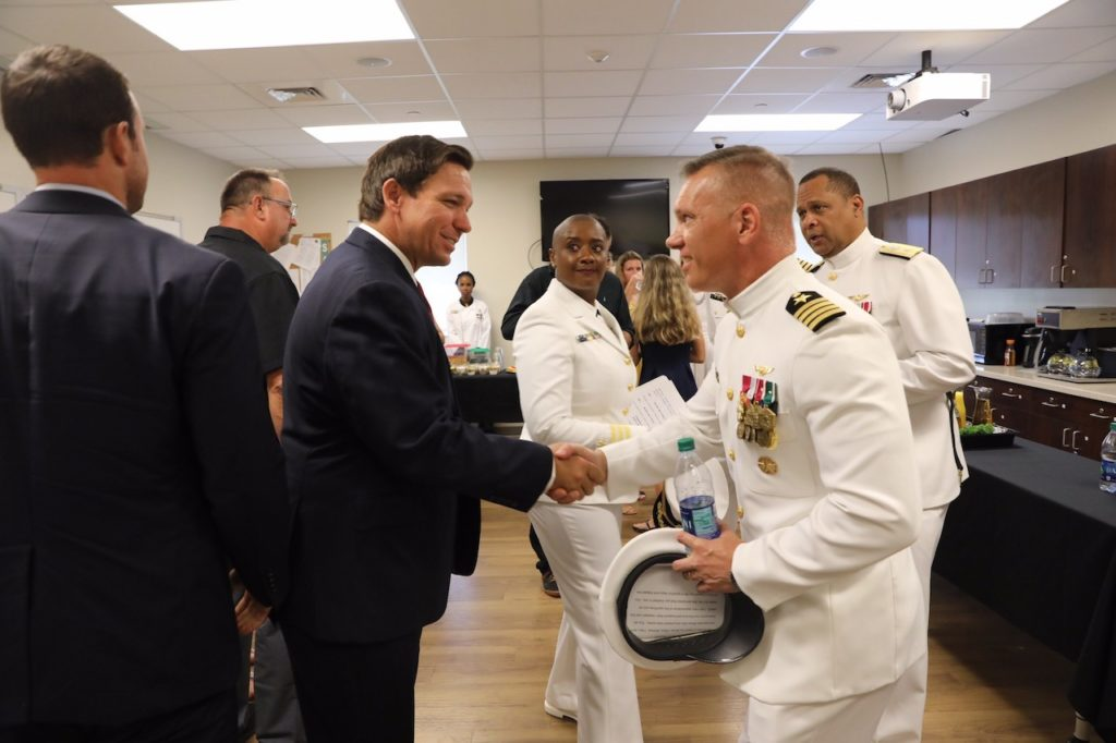 Governor Ron DeSantis shakes hands with Captain Canfield