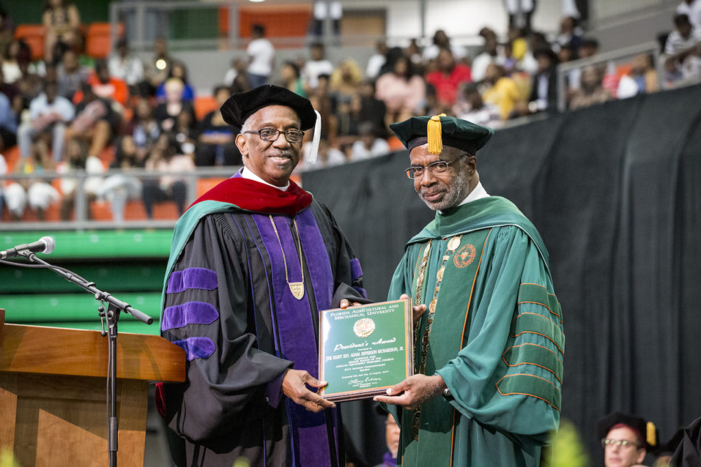Senior AME Bishop Adam J. Richardson Jr. (left) accepts award from FAMU President Larry Robinson, Ph.D.