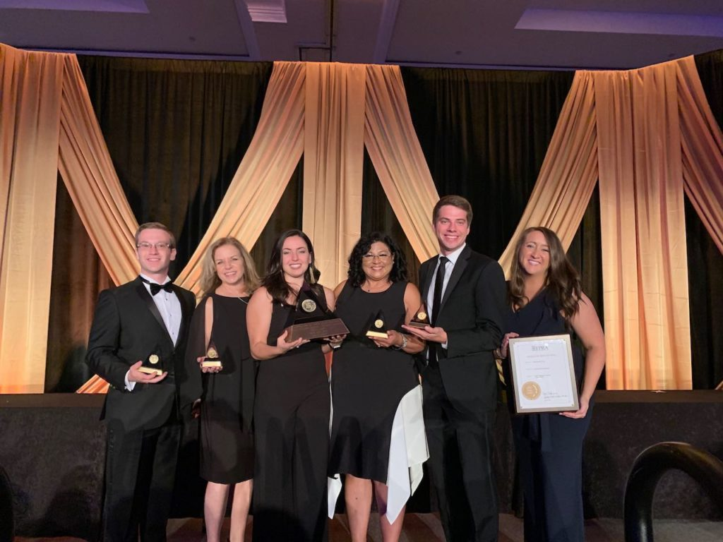 The Sachs Media Group team poses with their awards.
