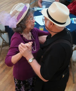 Photo of senior citizen couple dancing at the Inaugural Hats & Flats dance in Tallahassee.