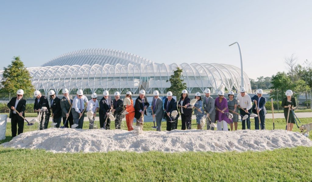Photograph of Florida Polytechnic University leaders and community and state officials holding shovels and breaking the ground on state-of-the-art research building.