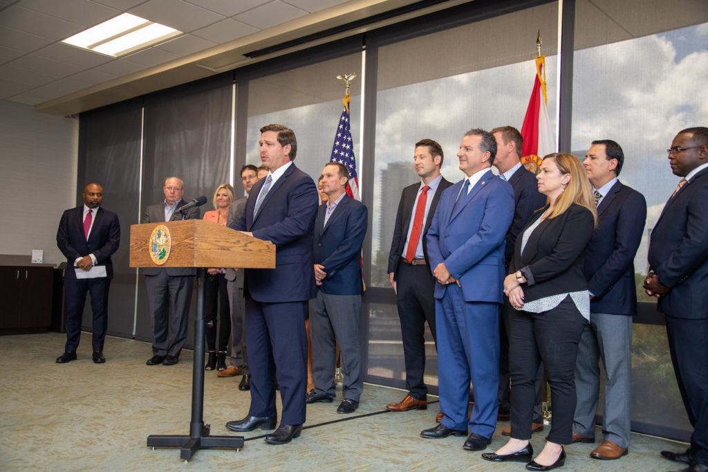 Photograph of Governor Ron DeSantis standing at podium Governor Ron DeSantis announcing initiatives.
