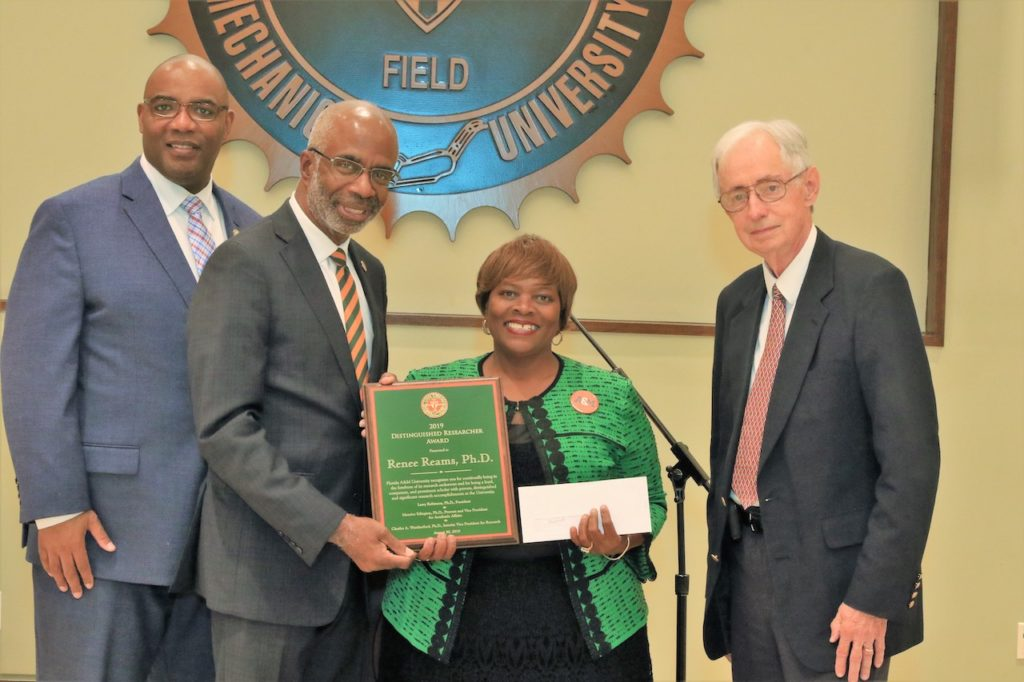 From left: Provost and Vice President of Academic Affairs Maurice Edington, Ph.D., President Larry Robinson, Ph.D., College of Pharmacy and Pharmaceutical Sciences Professor Renee Reams, Ph.D., recipient of the Distinguished Researcher Award, and Interim Vice President for Research Charles Weatherford, Ph.D.