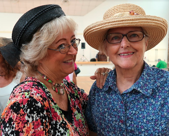 Two Tallahassee senior citizen women pose for a photograph at the inaugural Hats & Flats Dance in Tallahassee.