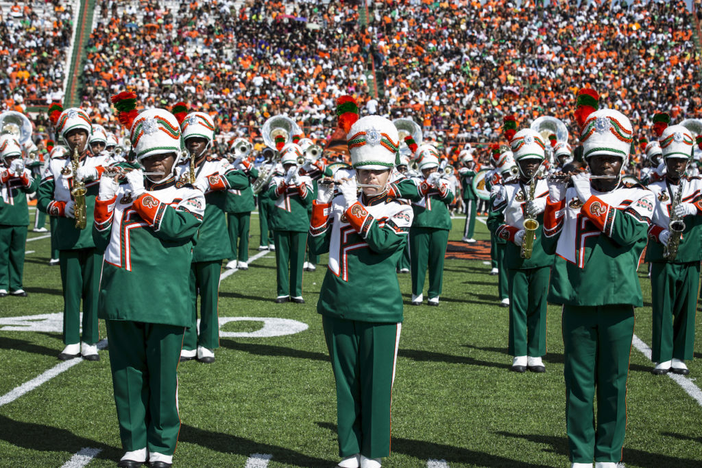 """The FAMU Marching """"100"""" performs on football field."""
