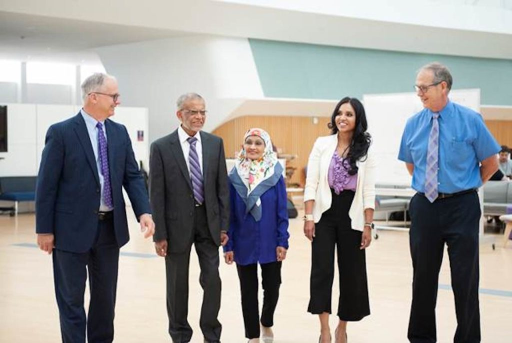 Florida Polytechnic University President Dr. Randy K. Avent (left) joins electrical and computer engineering professor Dr. Muhammad Rashid; his wife, Dr. Fatema Rashid; their daughter, Dr. Faeza Kazmier, a plastic surgeon; and Florida Poly Provost Dr. Terry Parker in the Innovation, Science, and Technology building.