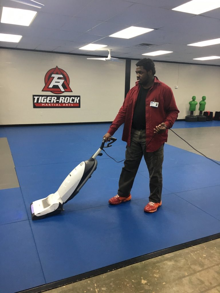 Jason Hunter enjoys being a custodian at Tiger Rock Martial Arts in Tallahassee.
