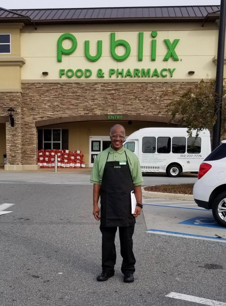 Kenny Burnett took on a second job at the Ocala Grand Oaks Town Center Publix to be able to support his family.