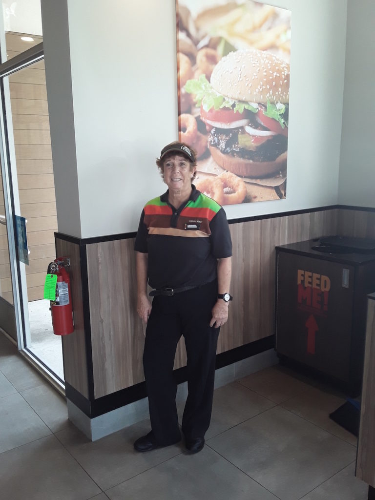 Linda Masessa helps customers have a great experience at the new Burger King in Stuart.