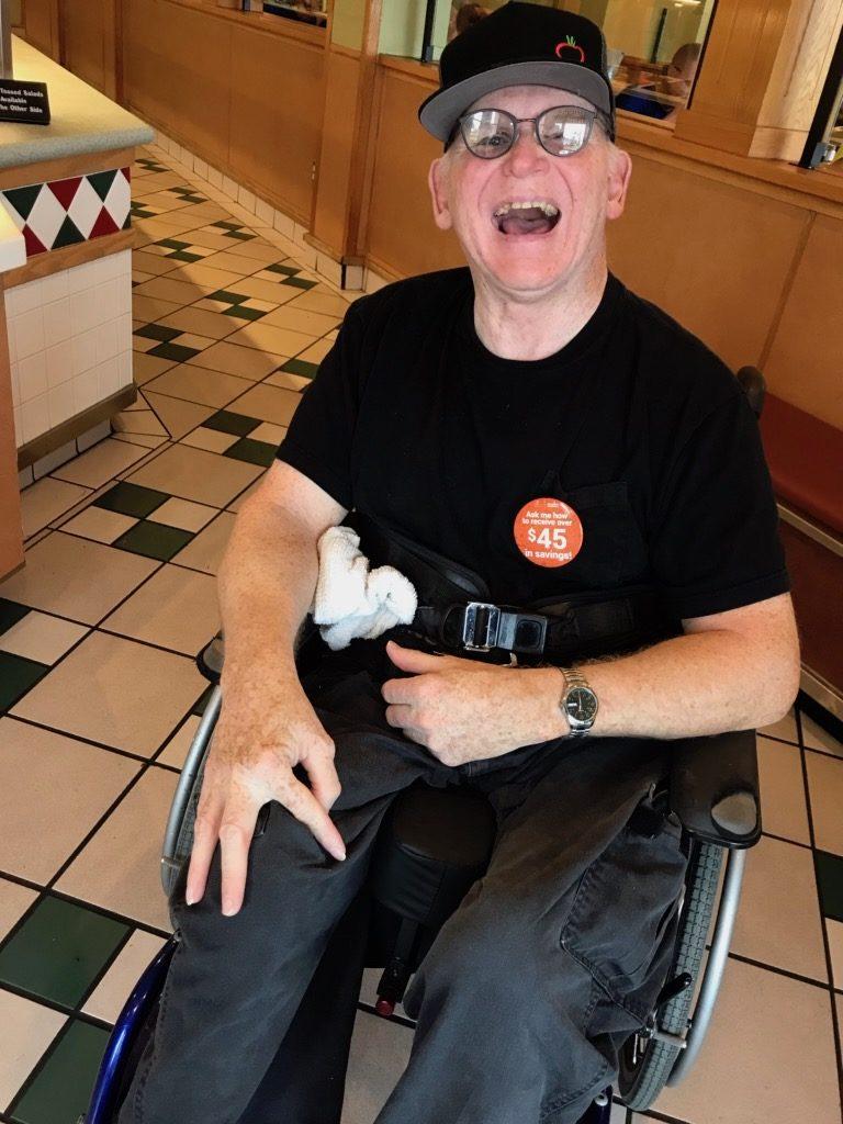 Matt Hightower is proud of his job greeting customers at Sweet Tomatoes in Sarasota.