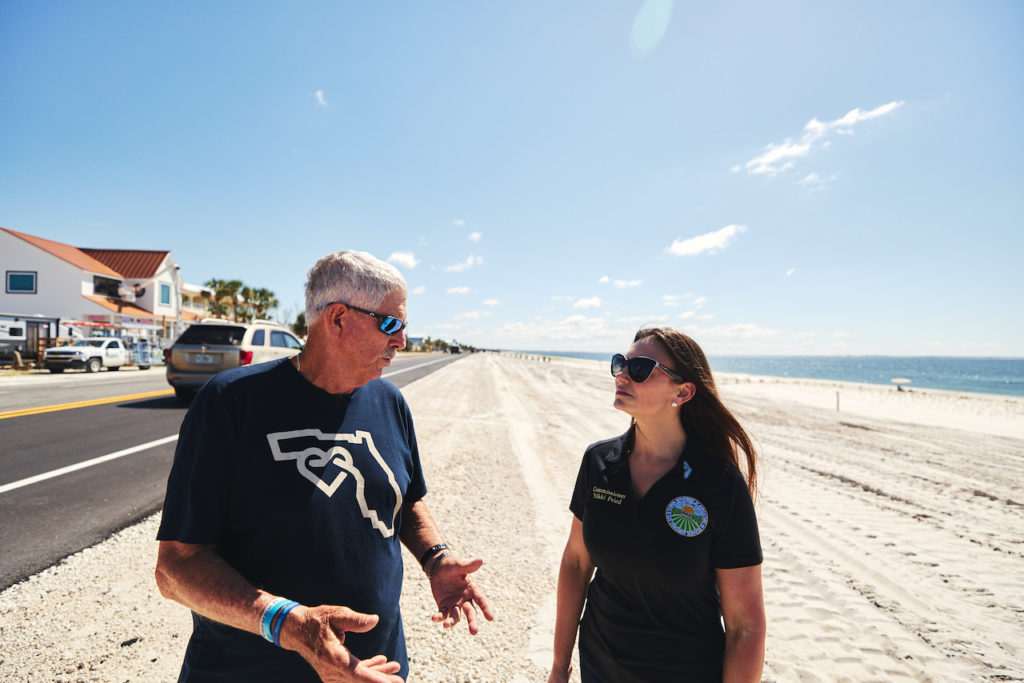 Commissioner Nikki Fried speaks with a resident on Mexico Beach.
