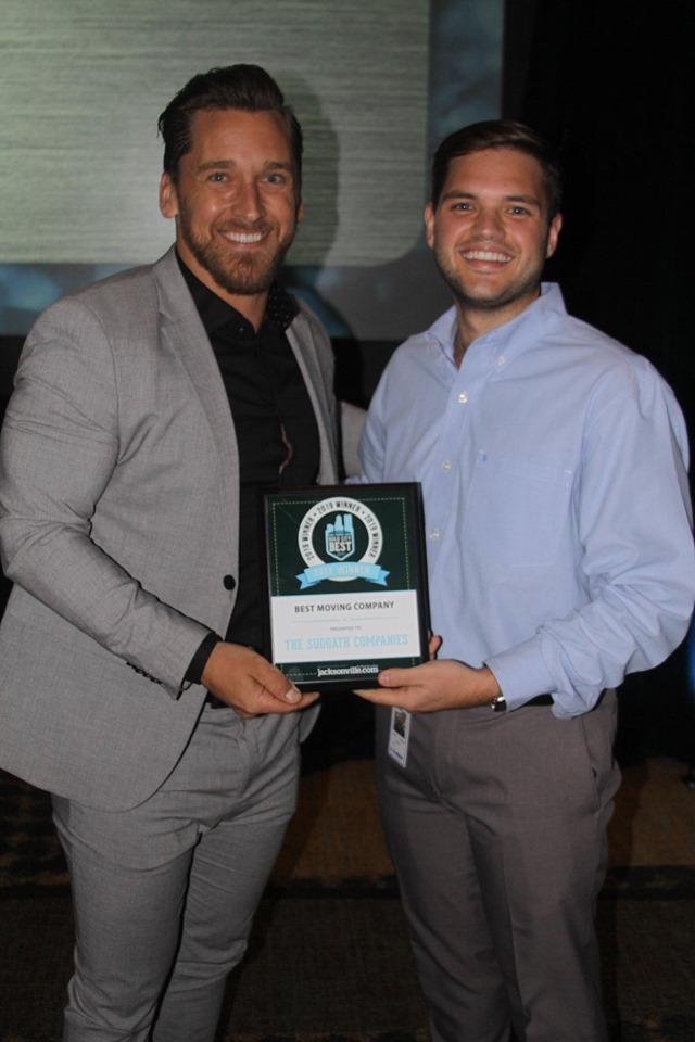 Scott Sheplak II (Left), local sales, and Mitchell Zvaigzne (Right), dispatch manager accepting the Best Moving Company award.