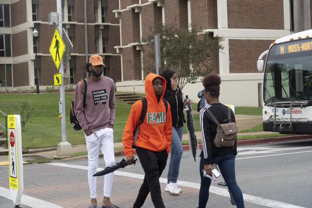 FAMU students walking through crosswalk.