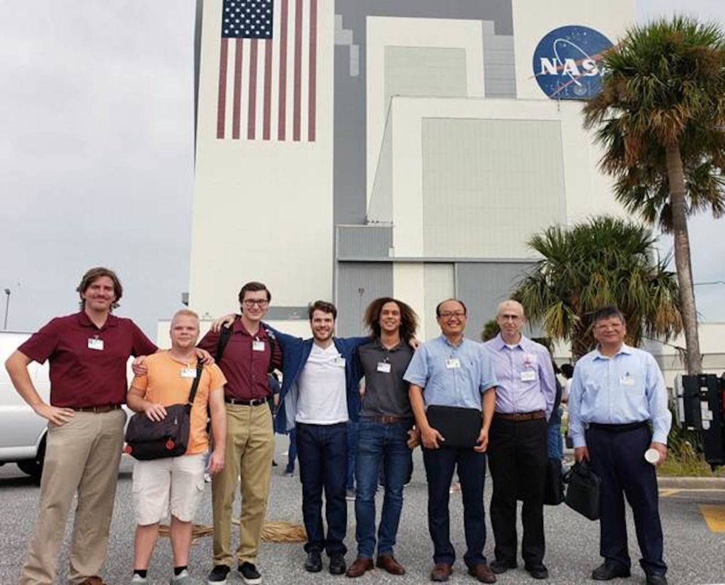 Florida Polytechnic University students Edward Davis, left, Brandyn Langston, Skyler Batteiger, Gabe Gamet, and Purcell Anderson, and faculty members Dr. Younggil Park, Dr. Onur Toker, and Dr. Feng-Jen Yang visit Kennedy Space Center as part of a team collaborating on a capstone project designing a planetary rover for the Florida Space Institute.