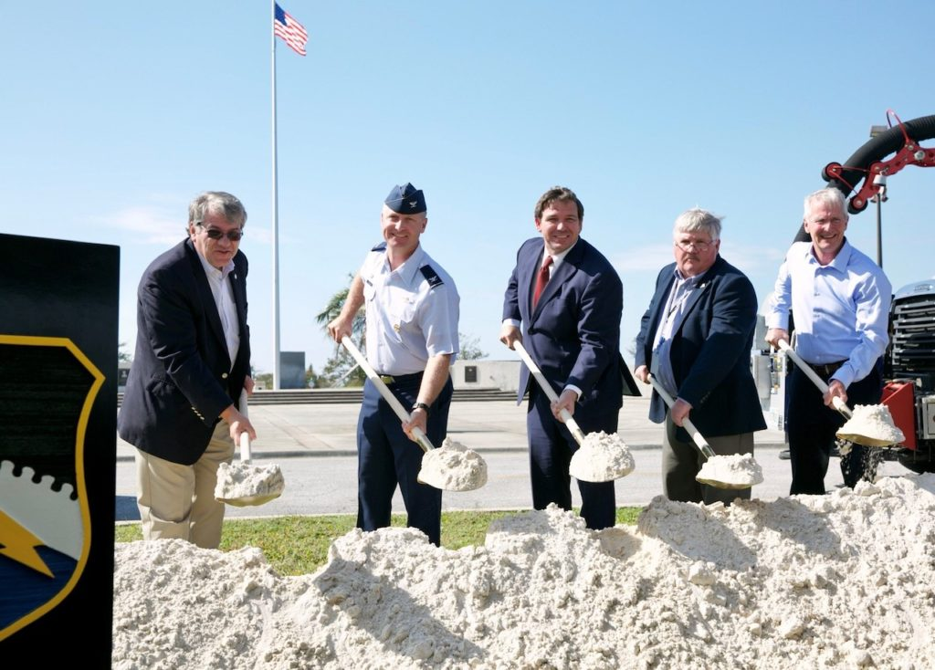 Governor Ron DeSantis, center, pictured holding a shovel at the groundbreaking ceremony of the Tyndall Flyover, a new project at Tyndall Air Force Base (AFB) that will improve access and security to the base.