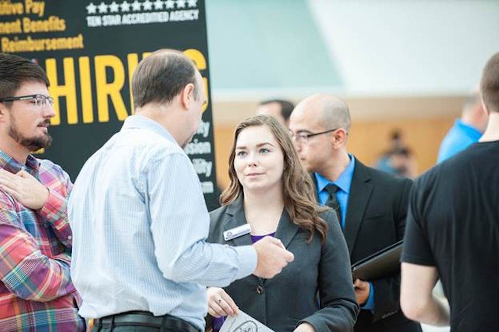 Florida Polytechnic University computer science major Delaney Jester connects with potential employers at the university's annual spring career fair in Lakeland, Florida.