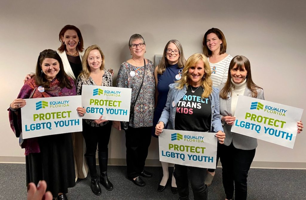 Participants of the Protect LGBT Youth press conference holding signs.