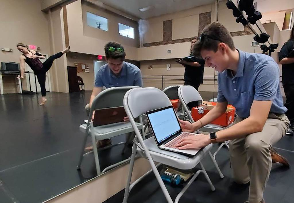 Jaimie Davis, an electrical engineering student at Florida Polytechnic University, monitors biosensor data generated by the movements of Florida Dance Theatre dancer Katrina Ogden in early March.