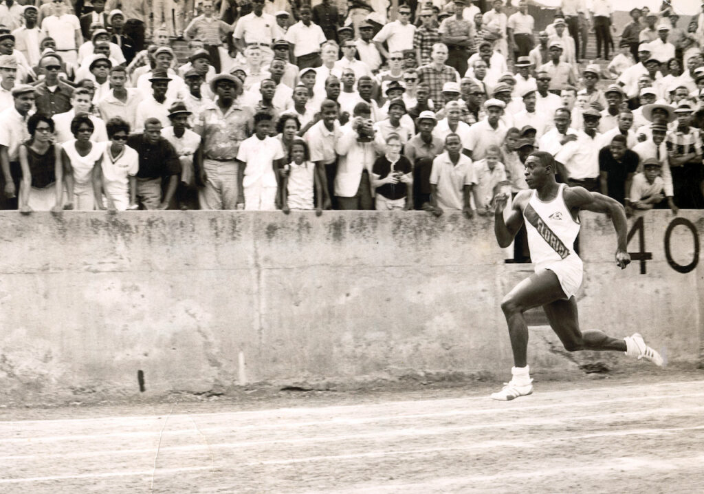 Bob Hayes running with both feet off the ground